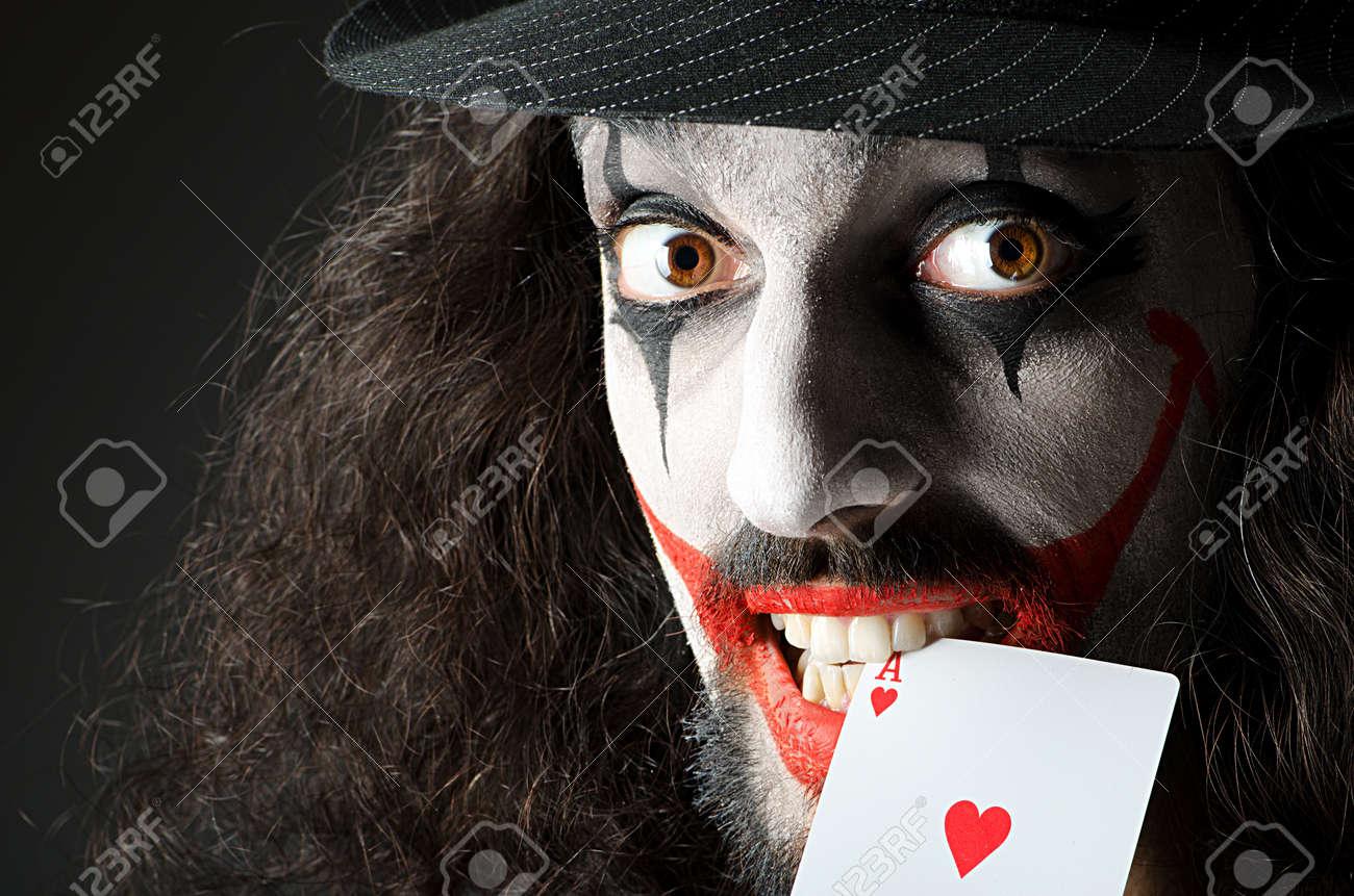 Joker with cards in studio shoot Stock Photo - 14409274