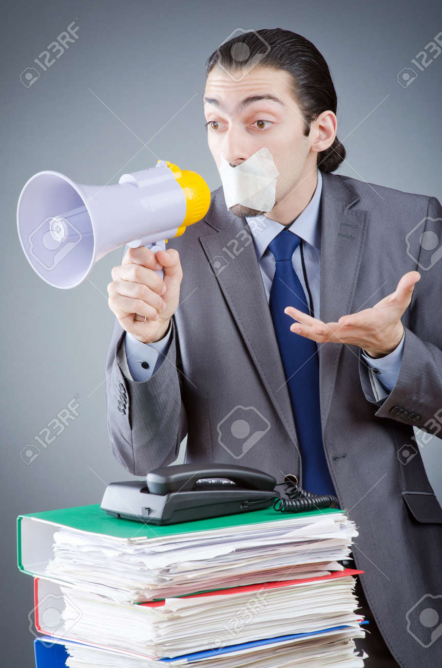 Businessman shouting via loudspeaker Stock Photo - 14425701