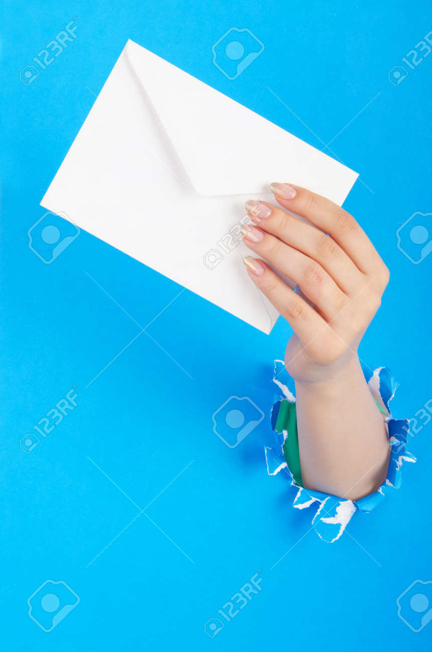 Hand holding paper envelope from hole Stock Photo - 14771474