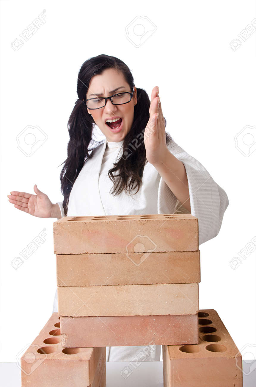 Woman karate breaking bricks on white Stock Photo - 14814412