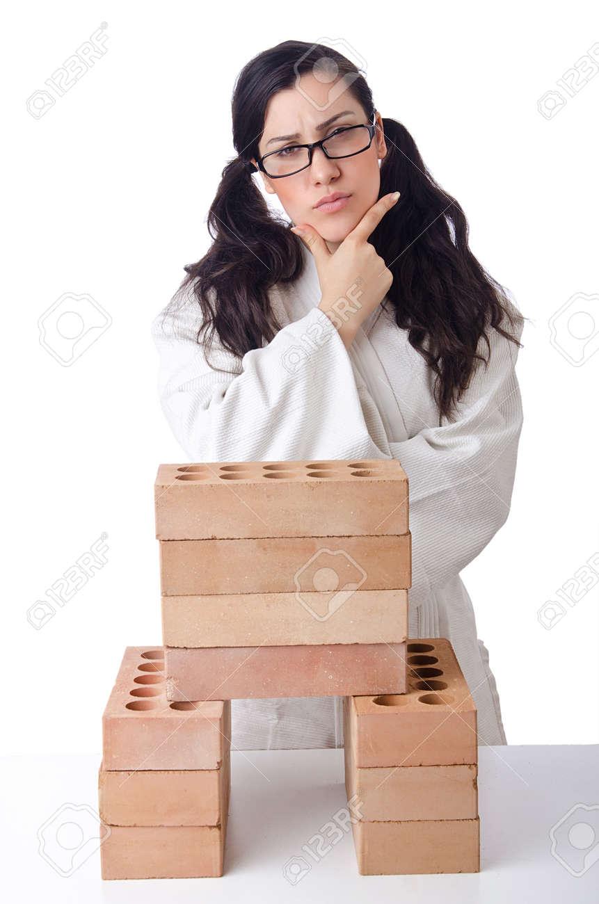 Woman karate breaking bricks on white Stock Photo - 15511127