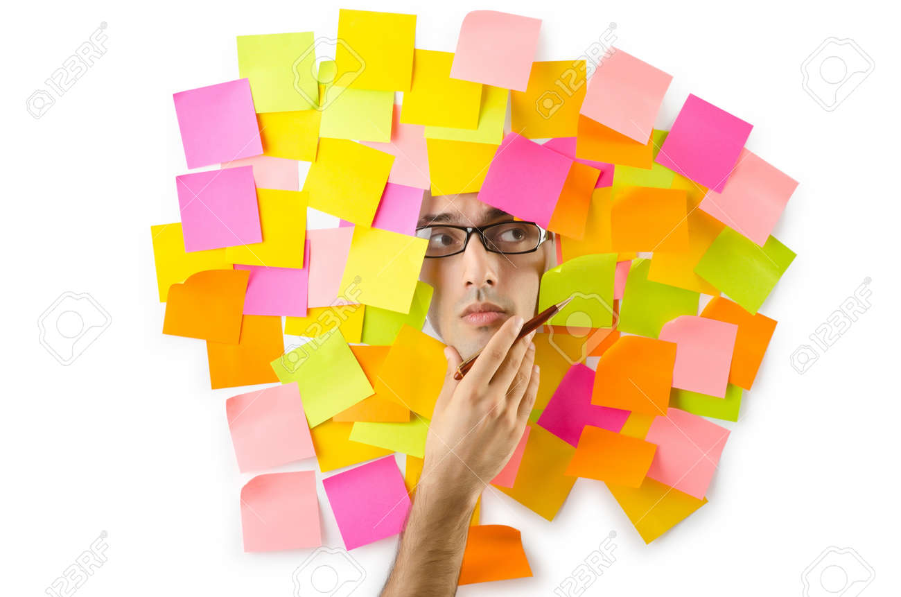 Man's face through paper and reminders Stock Photo - 15570988