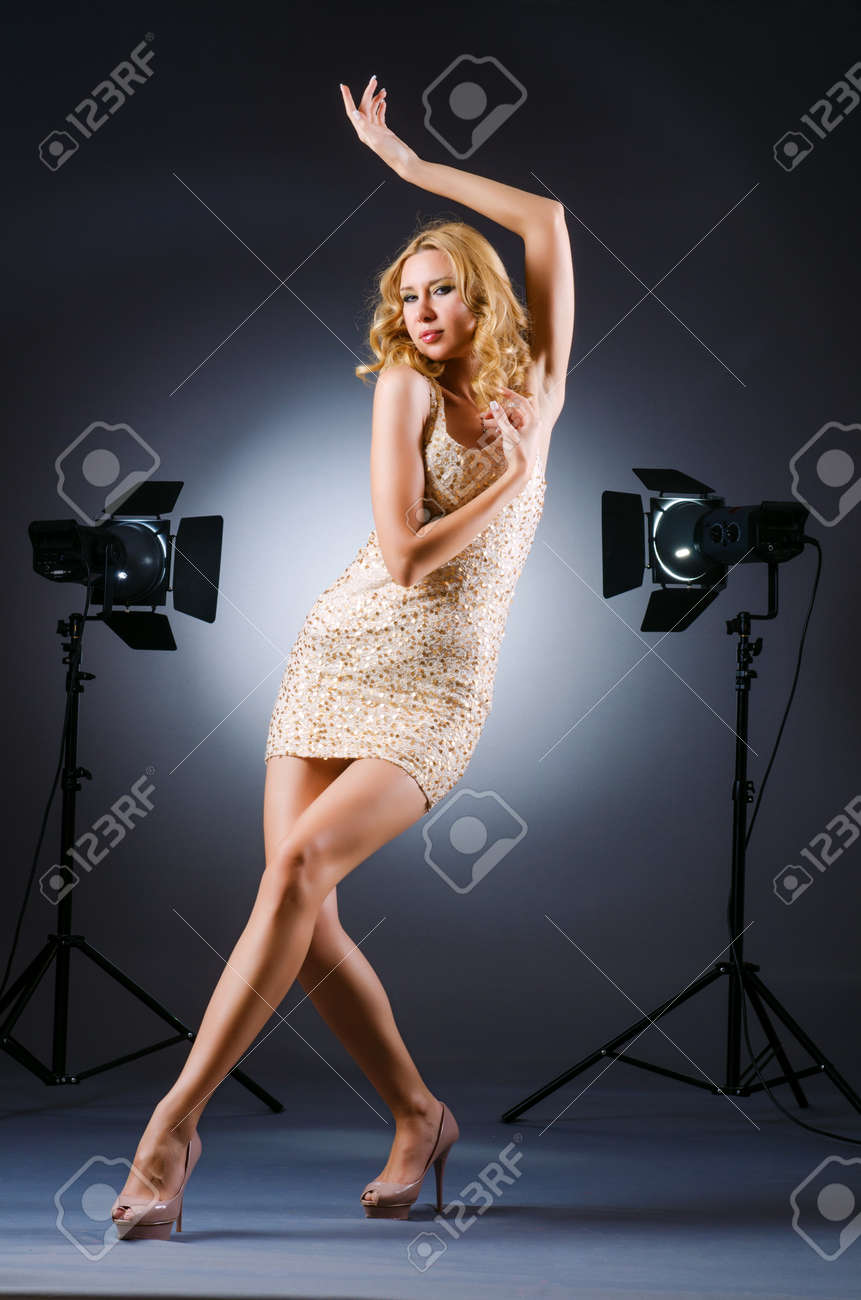 Attractive woman posing in photo studio Stock Photo - 15570842