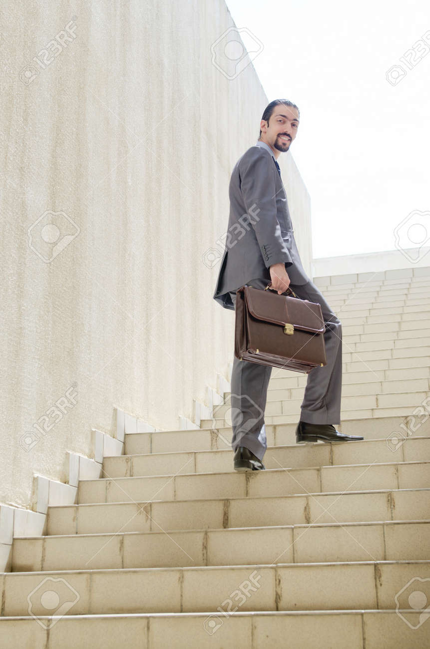 Businessman with stair in business concept Stock Photo - 16178568