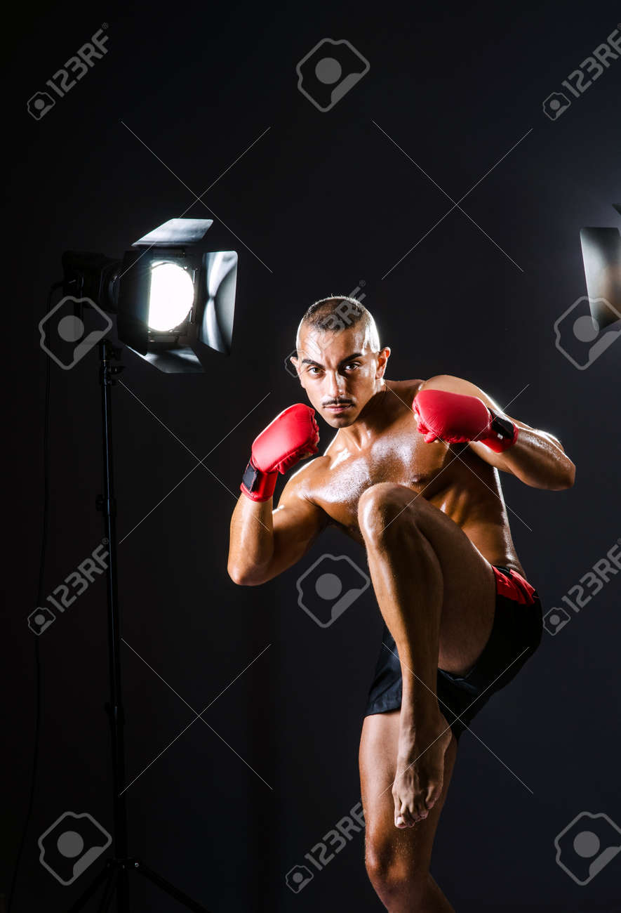 Boxer with studio lights in sports concept Stock Photo - 16748062