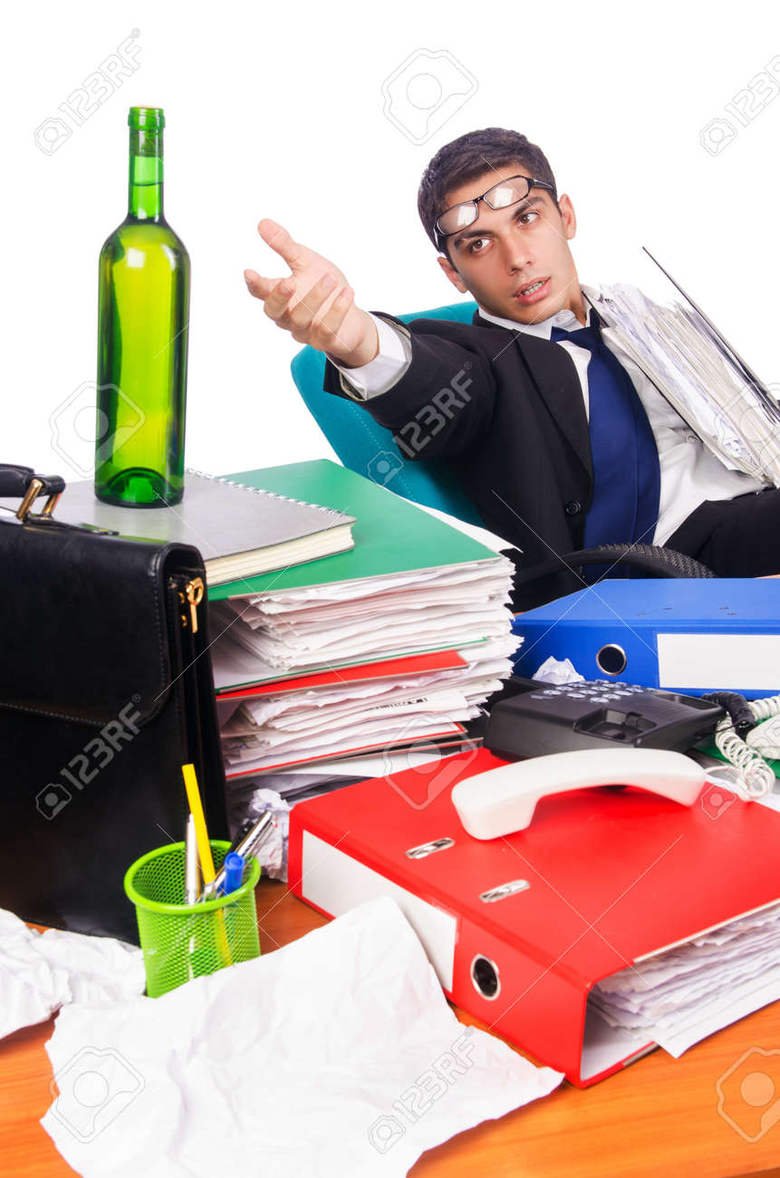 Young busy businessman at his desk Stock Photo - 18037634