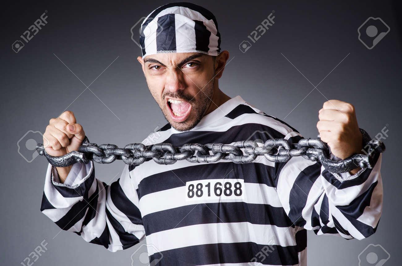 Convict criminal in striped uniform Stock Photo - 18037033