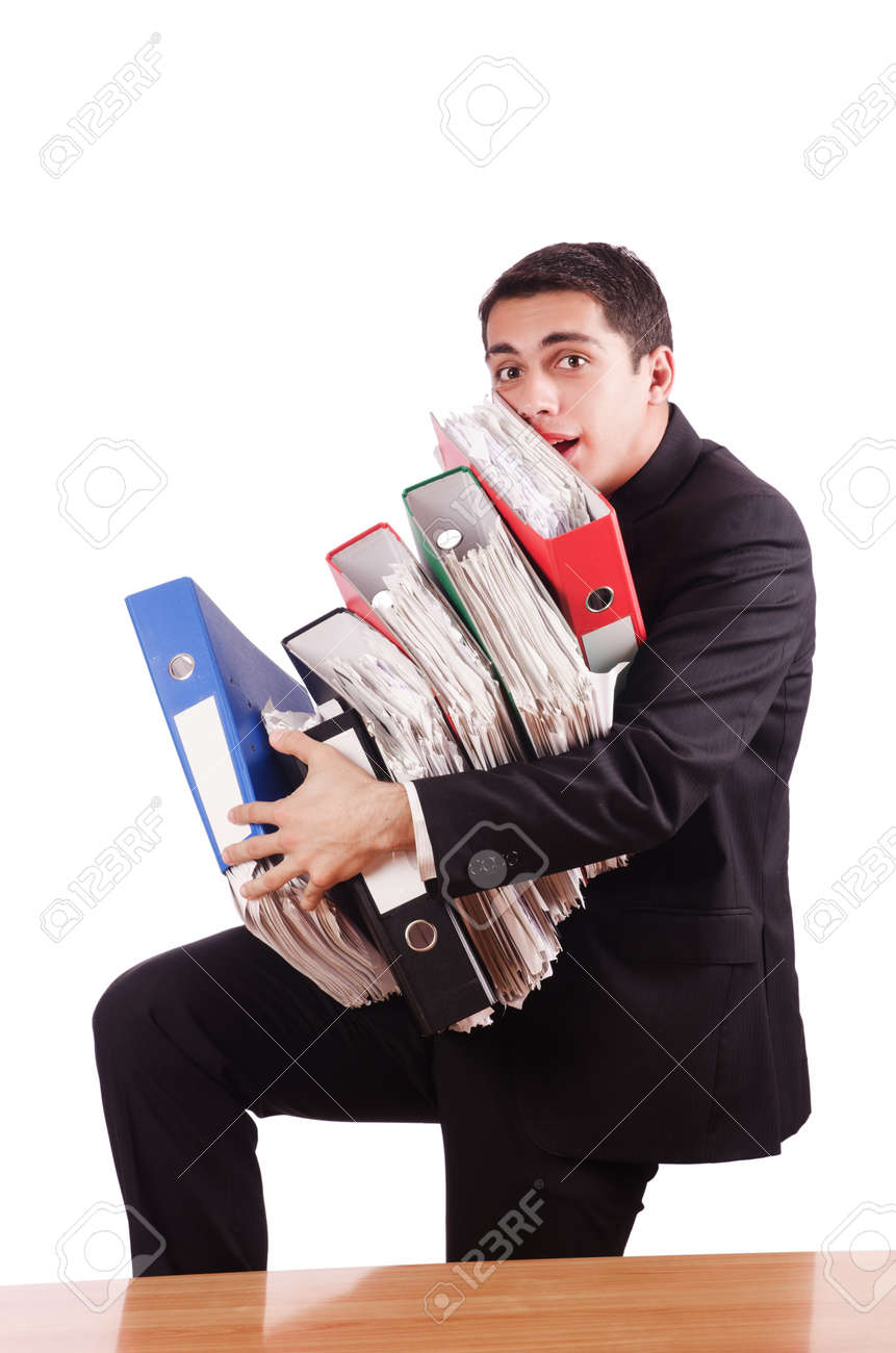 Young busy businessman at his desk Stock Photo - 18636625