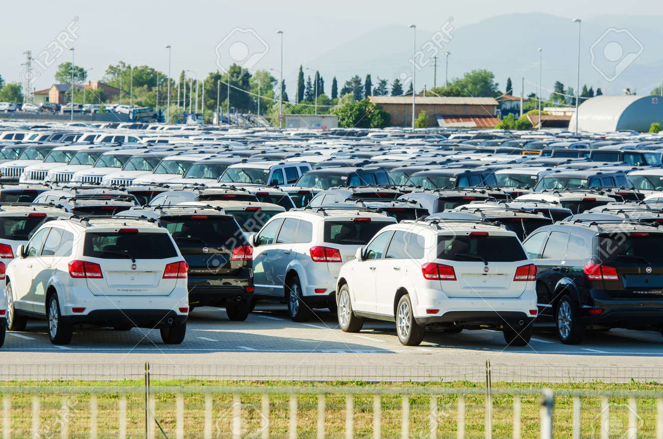 TUSCANY, ITALY - 27 June: New cars parked at distribution center in Tuscany, Italy. This one of biggest distribution centers in Italy. Stock Photo - 18306010