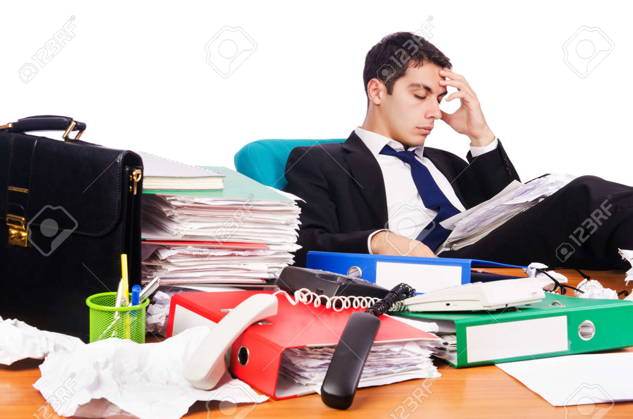 Young busy businessman at his desk Stock Photo - 18956853