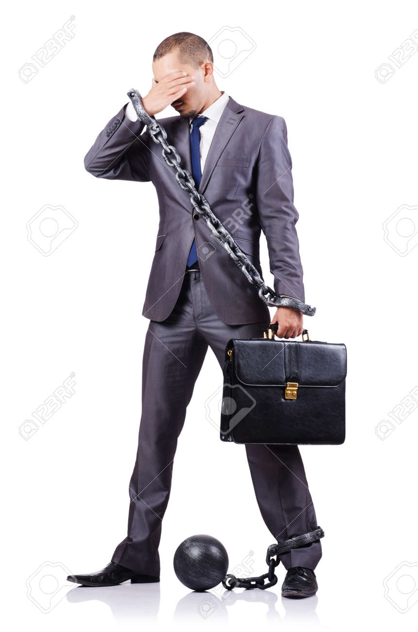 Businessman with shackles on white Stock Photo - 18654835