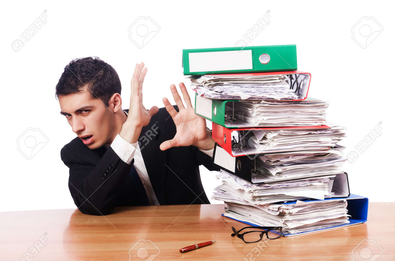 Young busy businessman at his desk Stock Photo - 18614925
