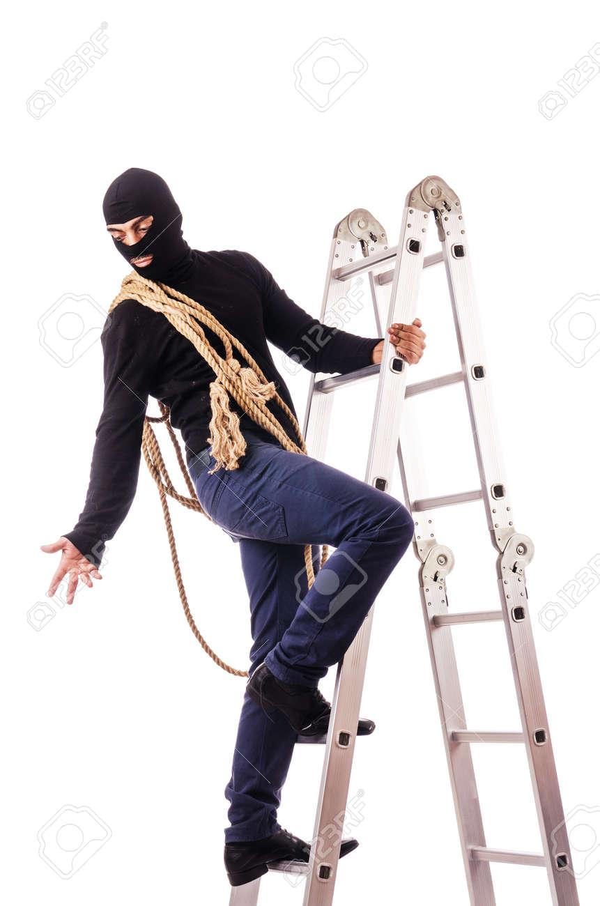 Burglar wearing balaclava isolated on white Stock Photo - 18680056