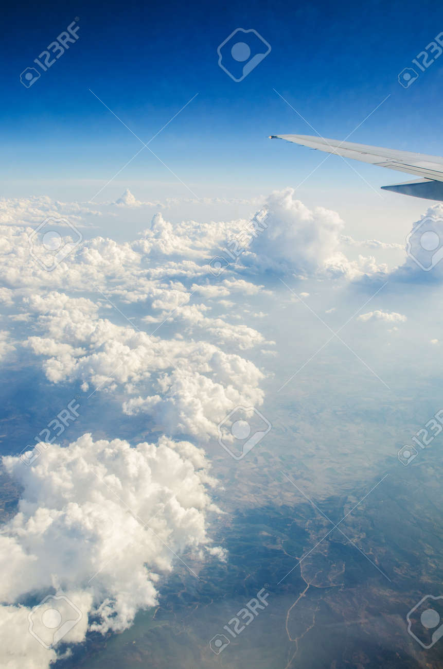 Airplane wing out of window Stock Photo - 18744924
