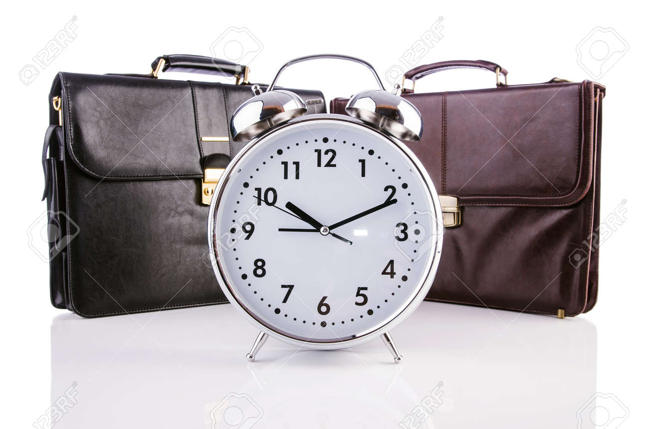 Alarm clock and briefcase isolated on white Stock Photo - 19039197