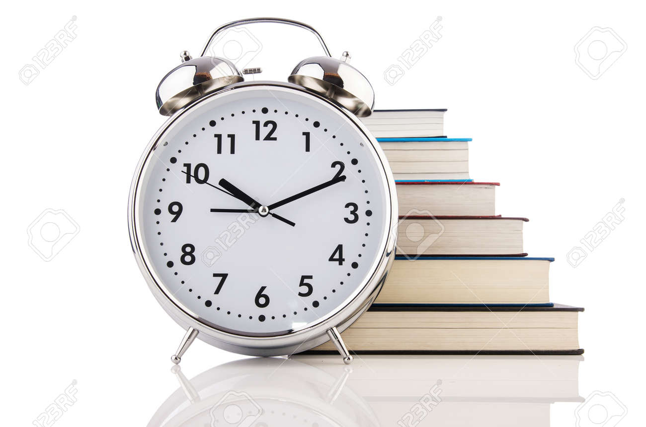 Alarm clock and books isolated on white Stock Photo - 19037257