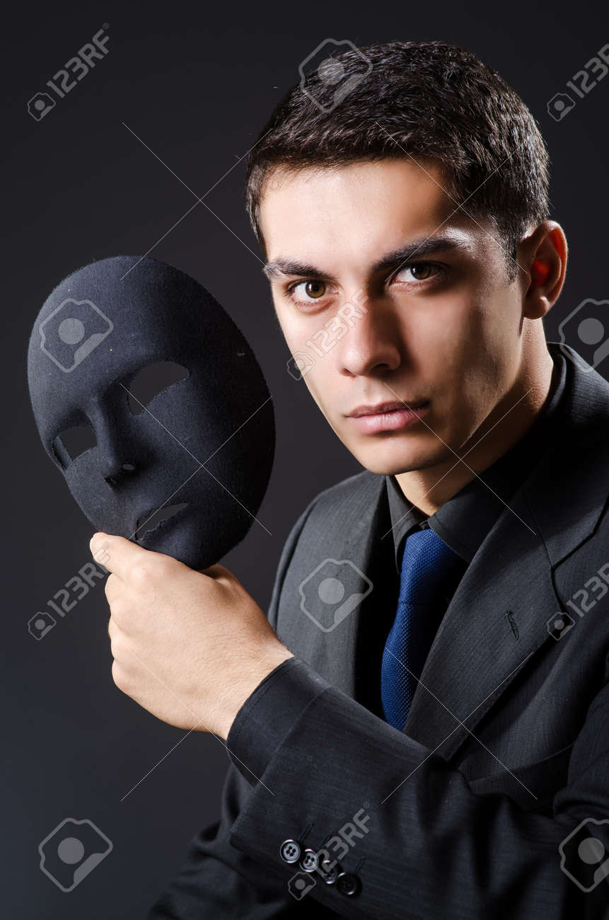 Man with mask in the dark Stock Photo - 19142372