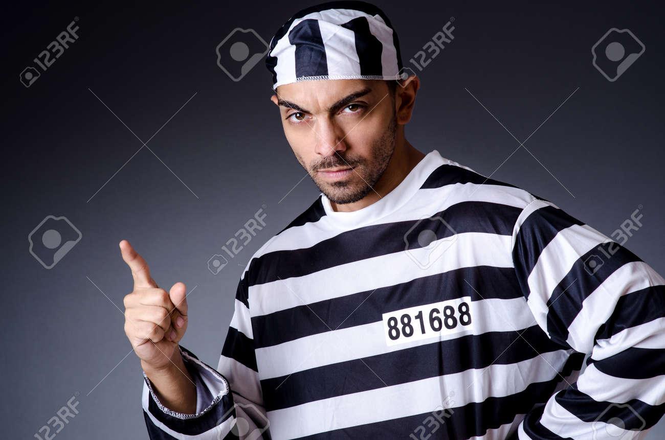 Convict criminal in striped uniform Stock Photo - 19137057