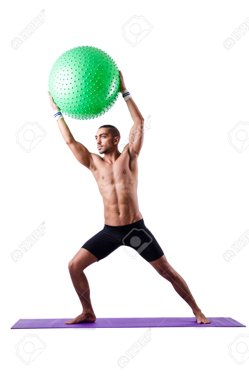 Man with swiss ball doing exercises on white Stock Photo - 19142425