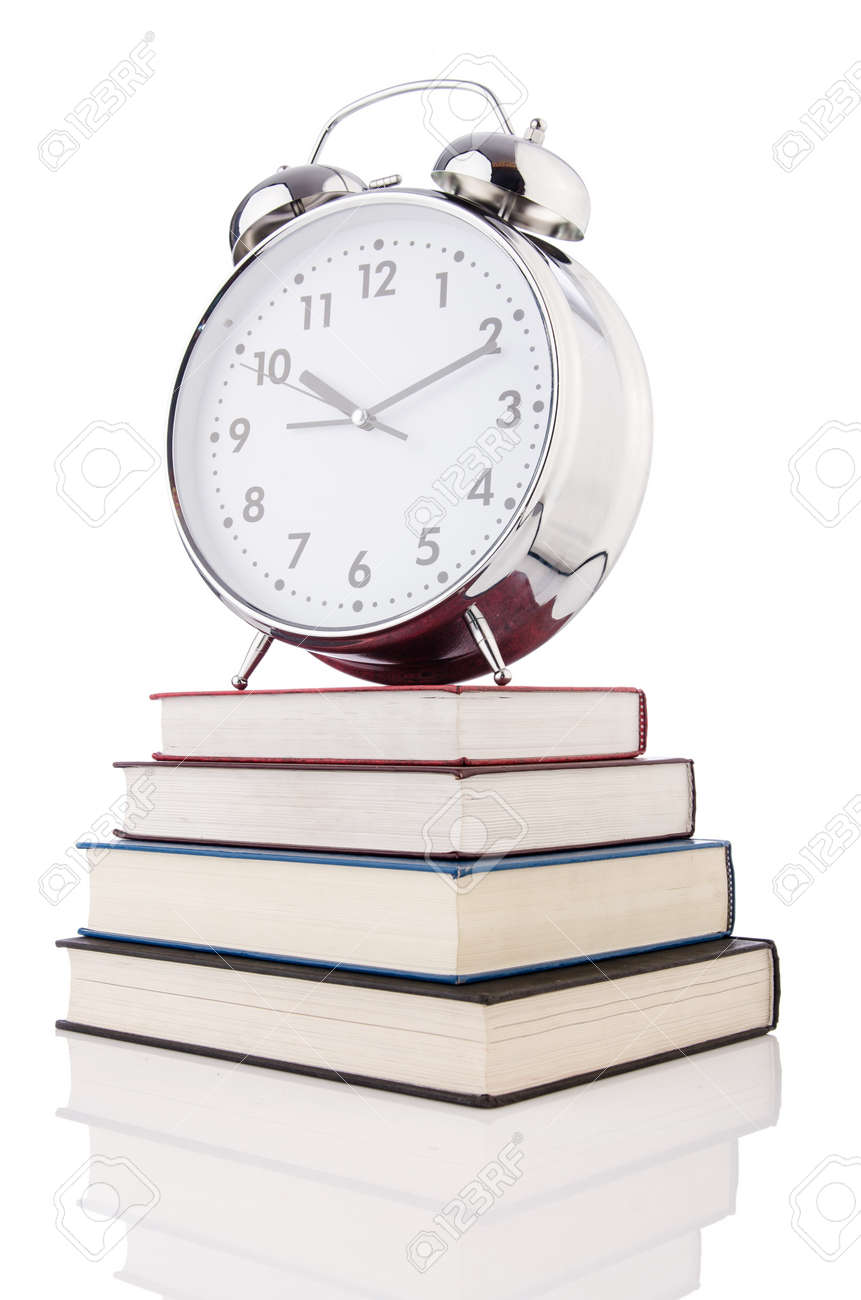 Alarm clock and books isolated on white Stock Photo - 19324773