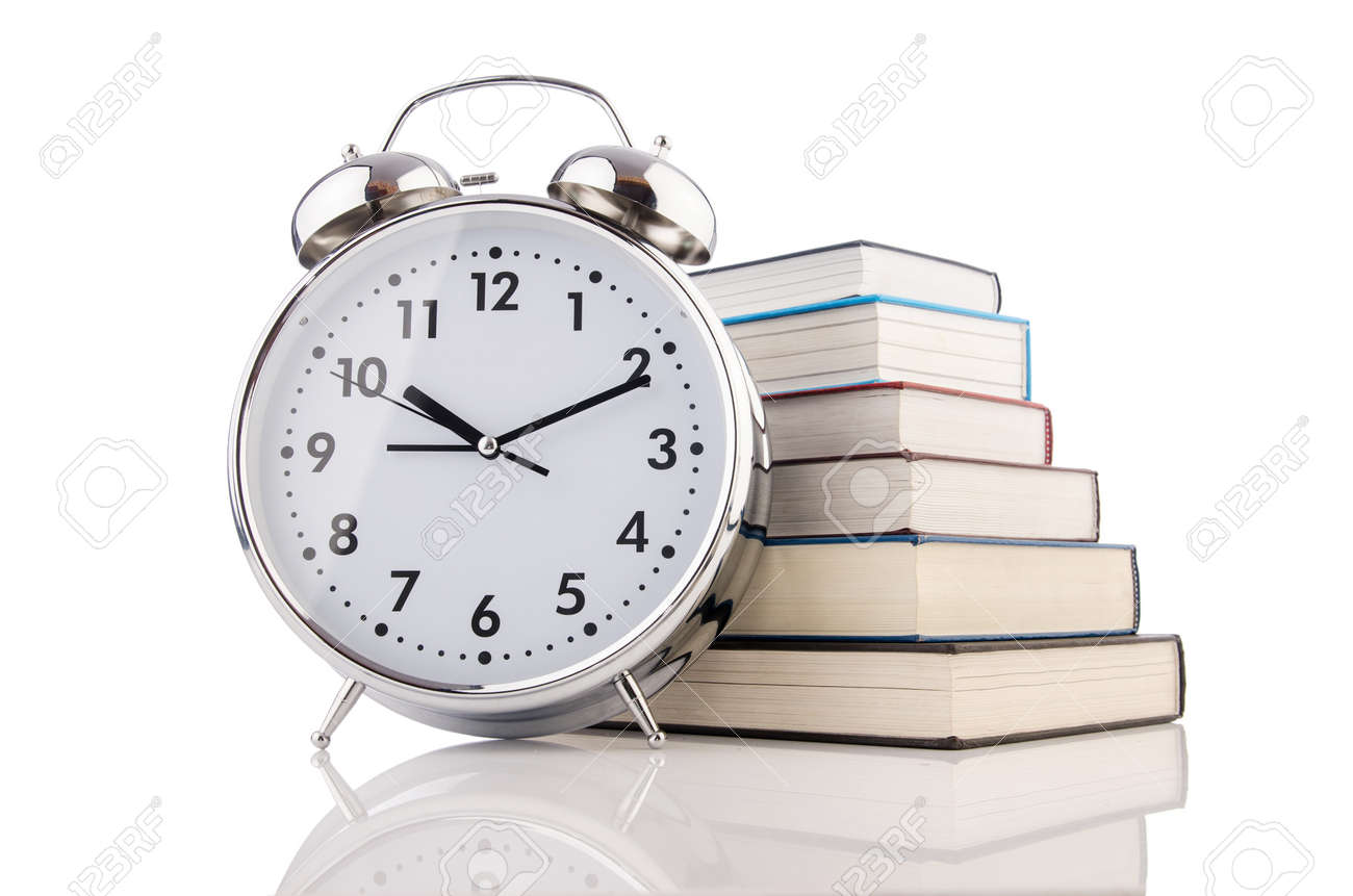 Alarm clock and books isolated on white Stock Photo - 19324748