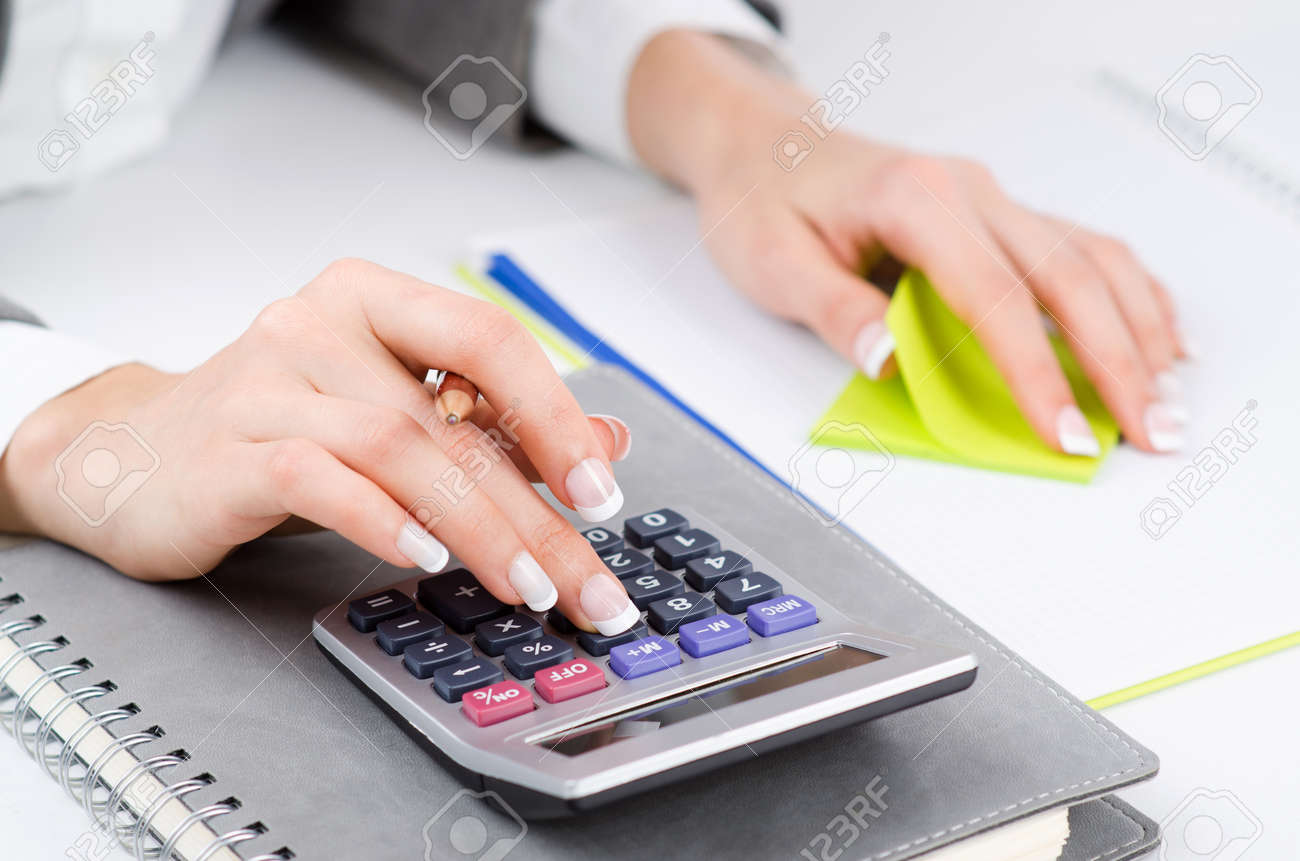 Hands working on the calculator Stock Photo - 19329250