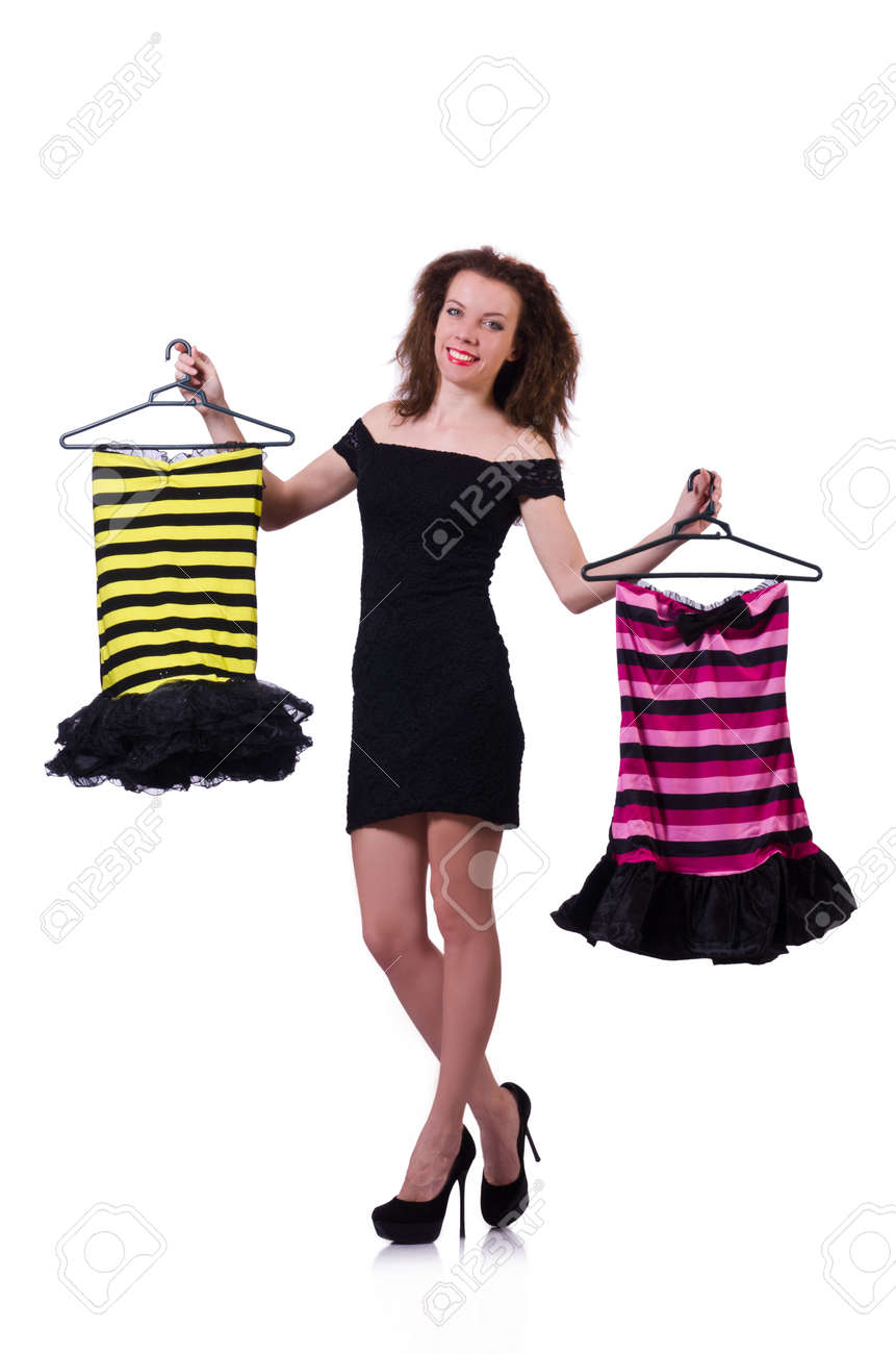Woman trying to choose dress on white Stock Photo - 19323142