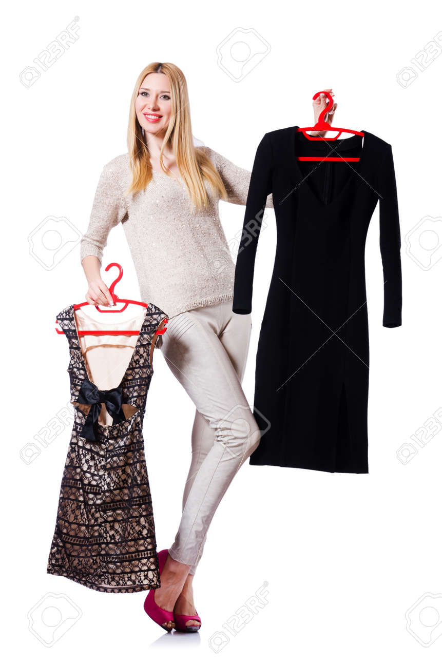 Woman trying to choose dress on white Stock Photo - 19433875