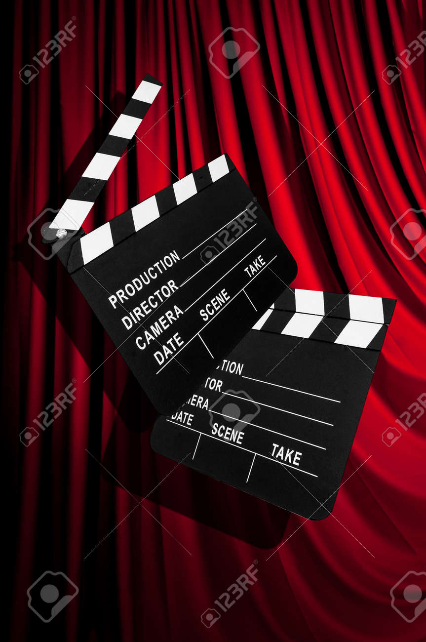 Movie clapper board against curtain Stock Photo - 19531515