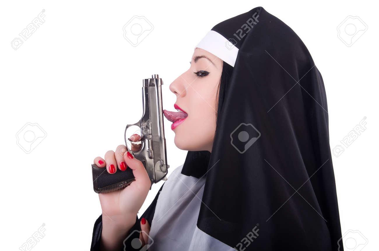 Nun with gun isolated on the white Stock Photo - 20258779