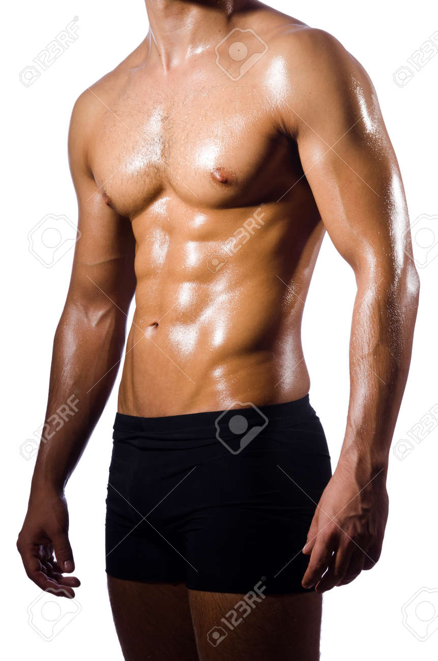 Muscular man isolated on the white Stock Photo - 19674383