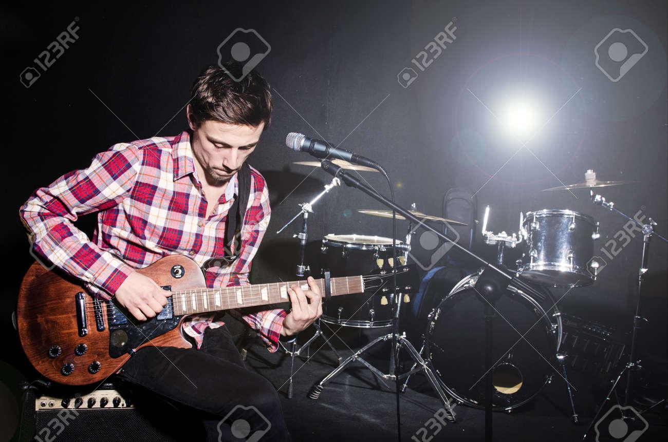 Man playing guitar during concert Stock Photo - 20101668