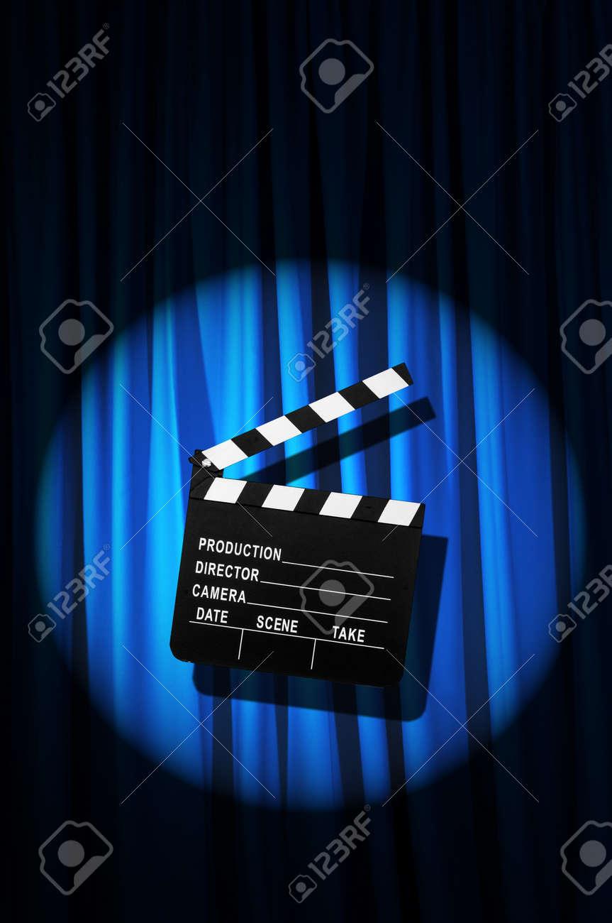 Movie clapper board against curtain Stock Photo - 20838809