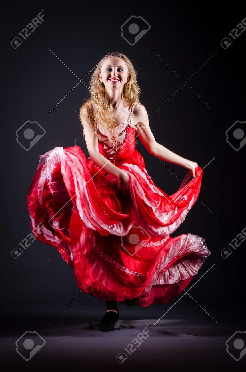 Girl in red dress dancing dance Stock Photo - 21077137