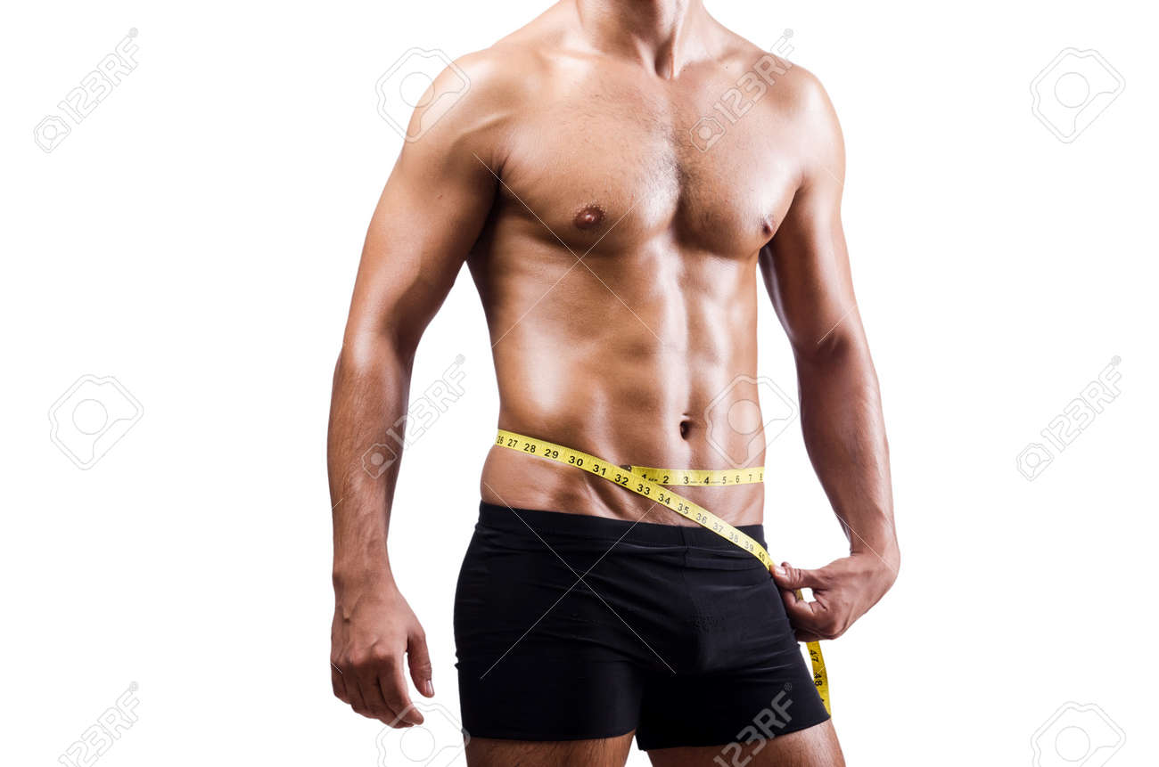 Muscular man measuring his muscles Stock Photo - 20838856