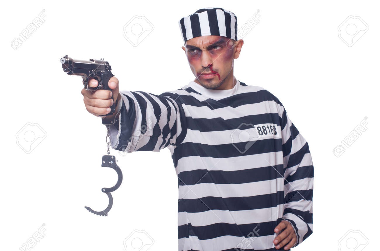 Badly bruised prisoner with gun Stock Photo - 22046333