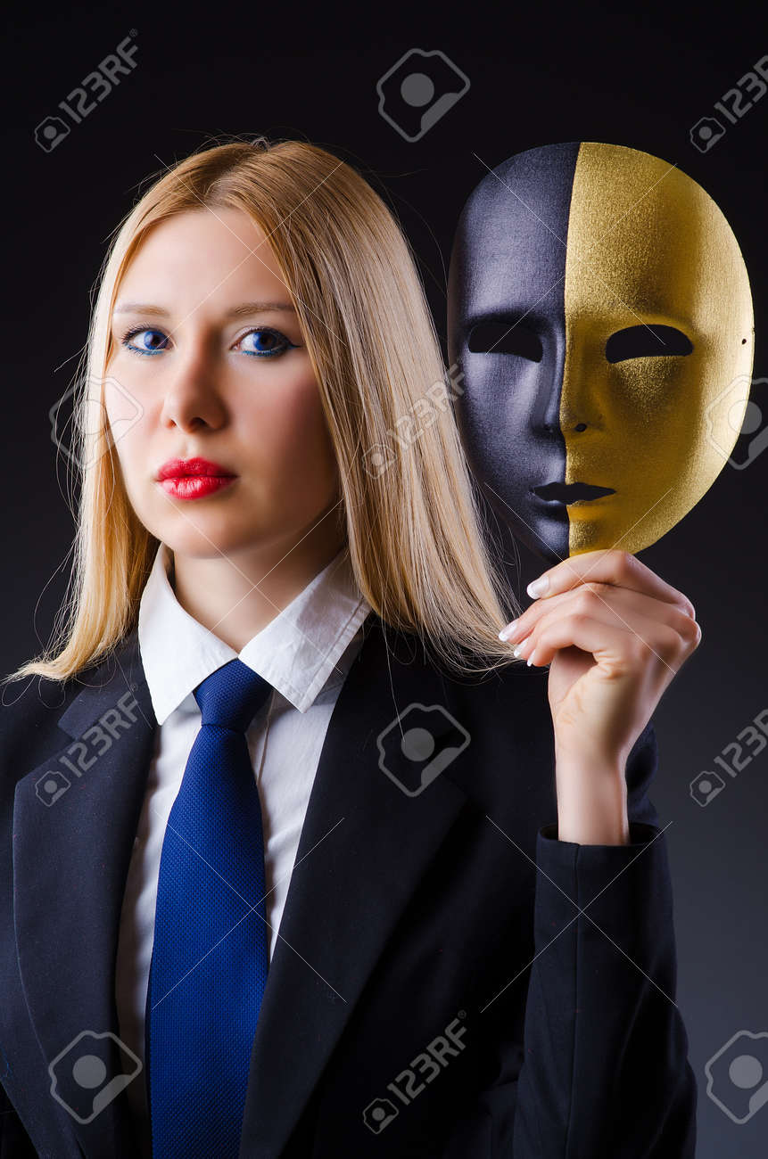 Woman with mask in hypocrisy concept Stock Photo - 22128286