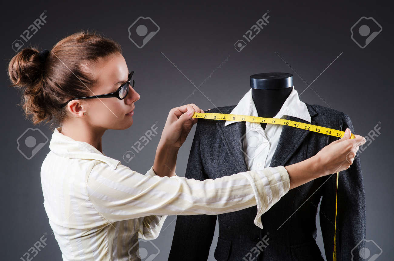 Woman tailor working on clothing Stock Photo - 23082245