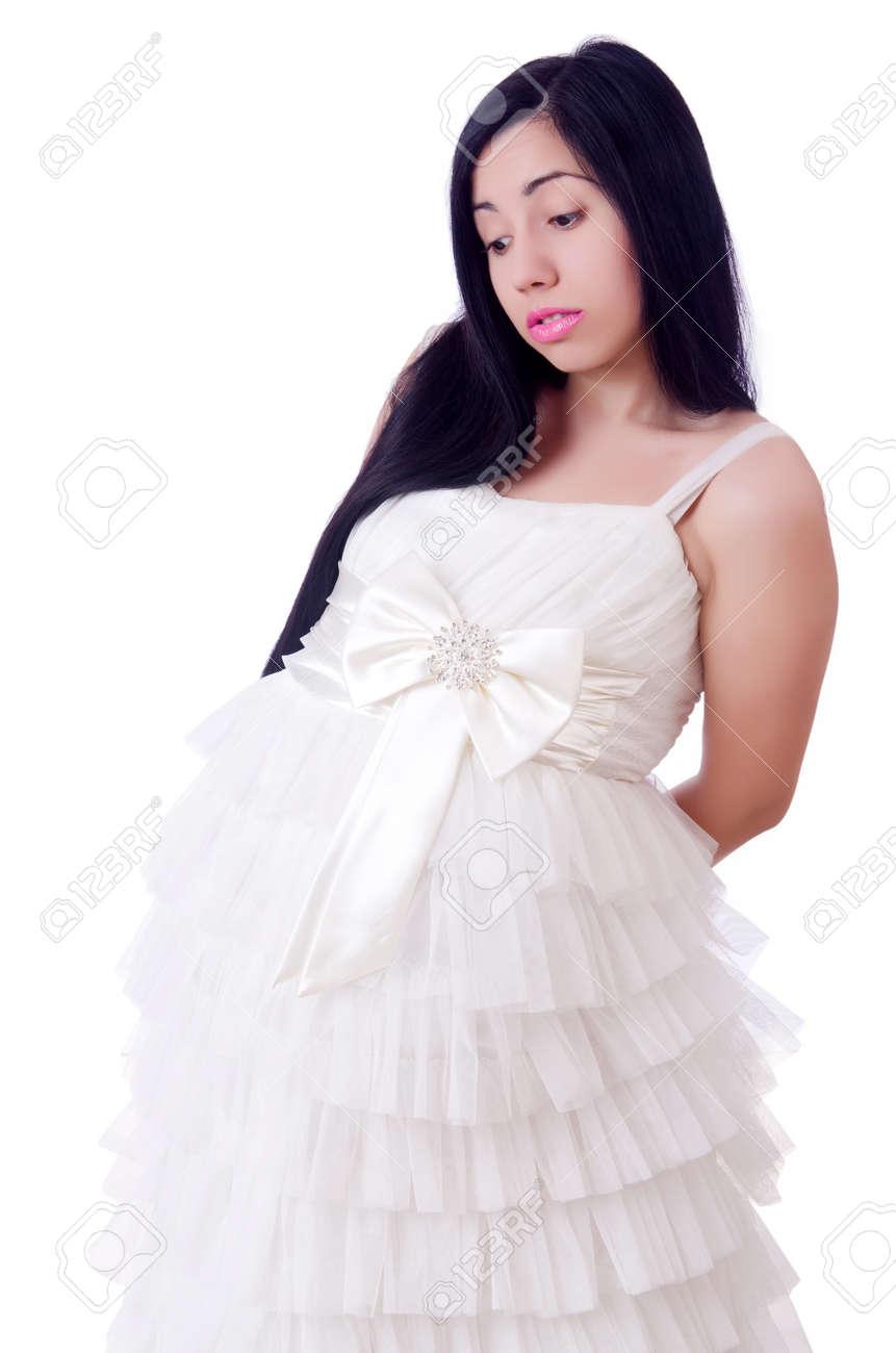 Pregnant Wedding Dress.Pregnant Woman In Wedding Dress On White