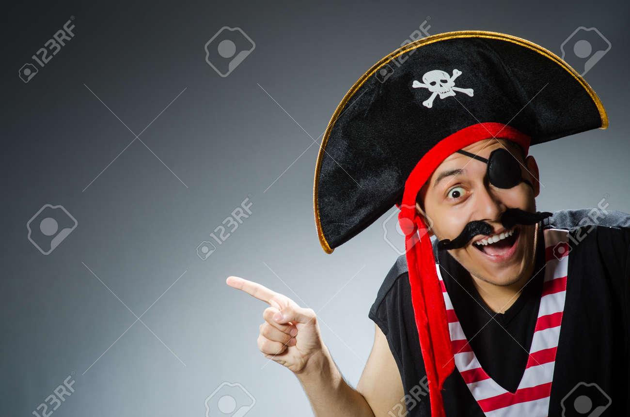 Funny pirate in the dark studio Stock Photo - 29899330