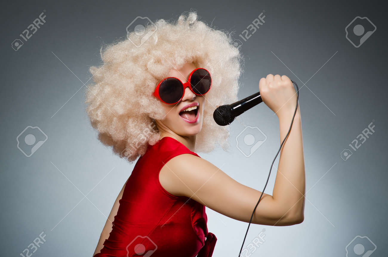 Young woman with mic in music concept Stock Photo - 31942619