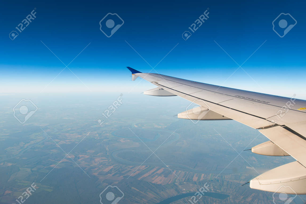 Airplane wing out of window - 37751871