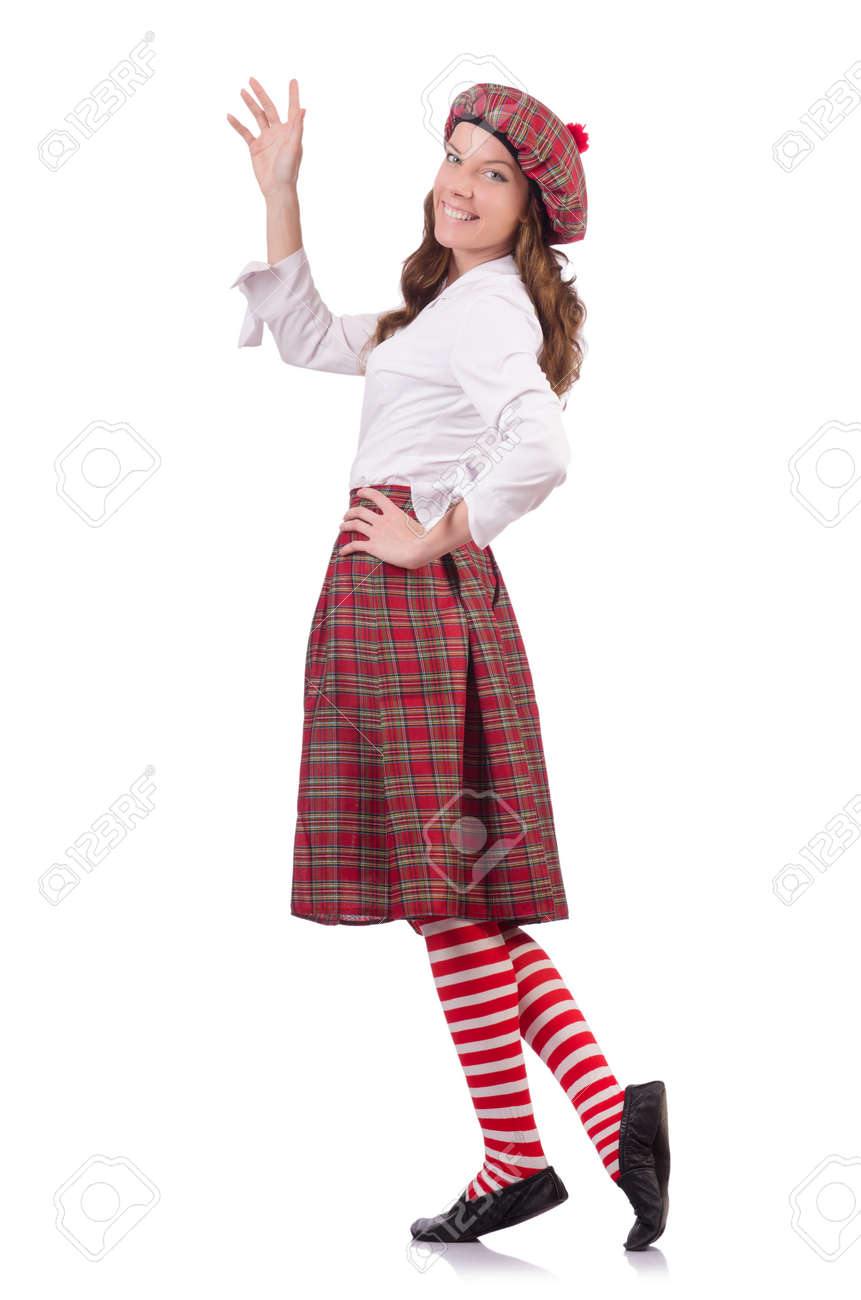Pretty girl in plaid Scottish clothing isolated on white