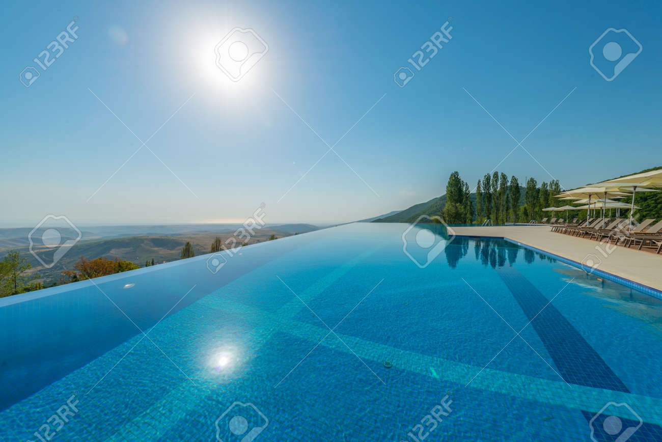 Infinity pool on the bright summer day Stock Photo - 45171771