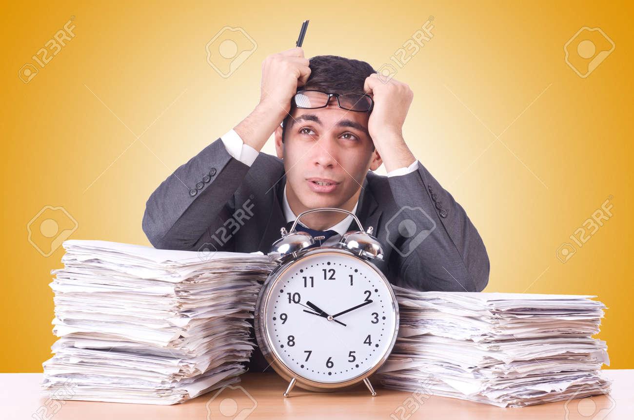 Woman businessman with giant alarm clock Stock Photo - 45939902