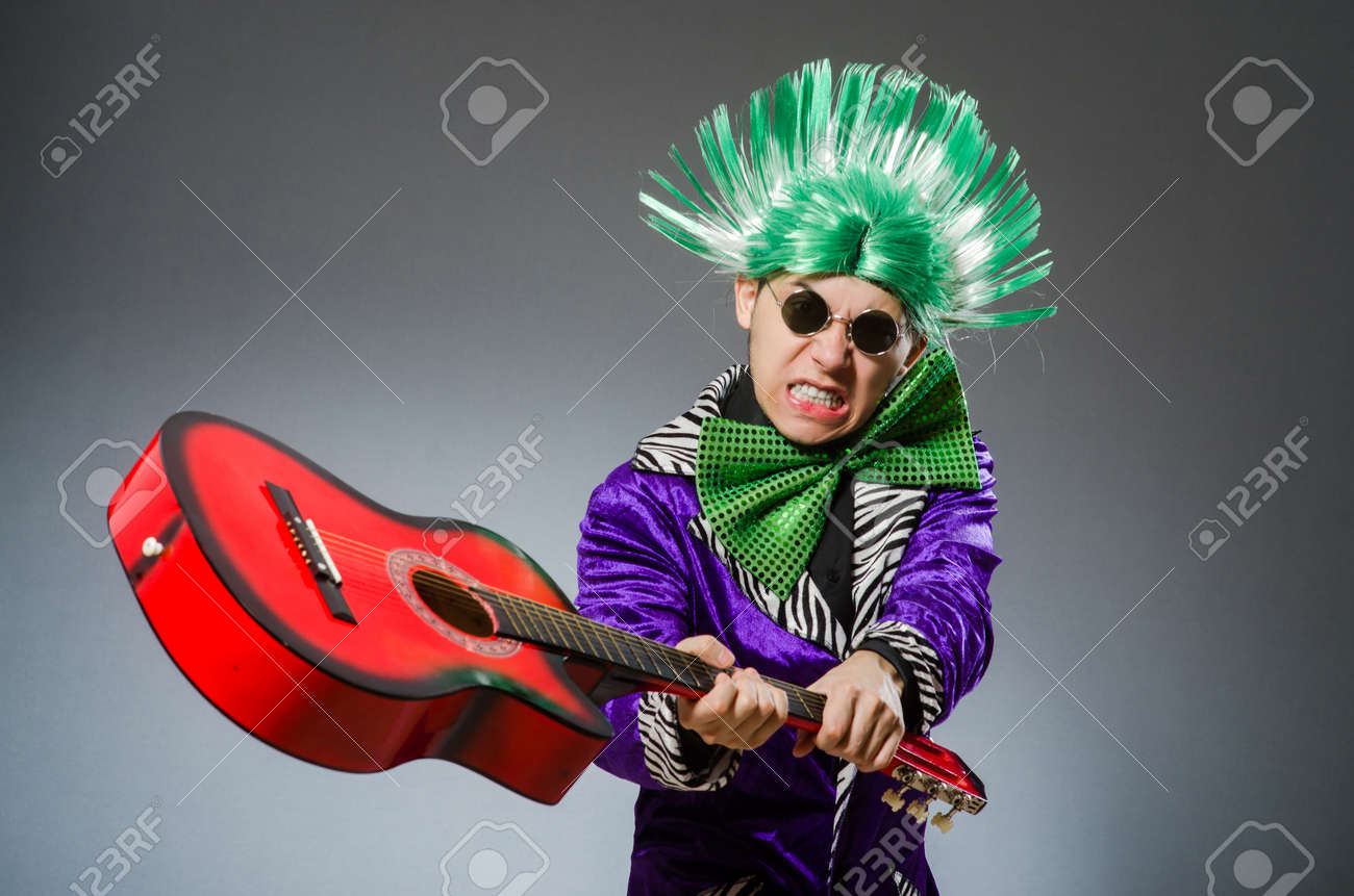 Funny man playing guitar in musical concept Stock Photo - 46359167