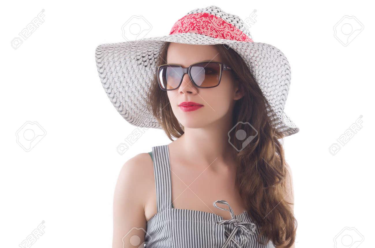 Archivio Fotografico - Giovane donna che indossa cappello e vestito a righe  grigio isolato su bianco 9acf60d49fe7