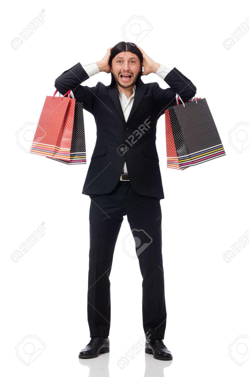 0688d6eaba9 Stockfoto - Zwart pak man met plastic zakken op wit wordt geïsoleerd