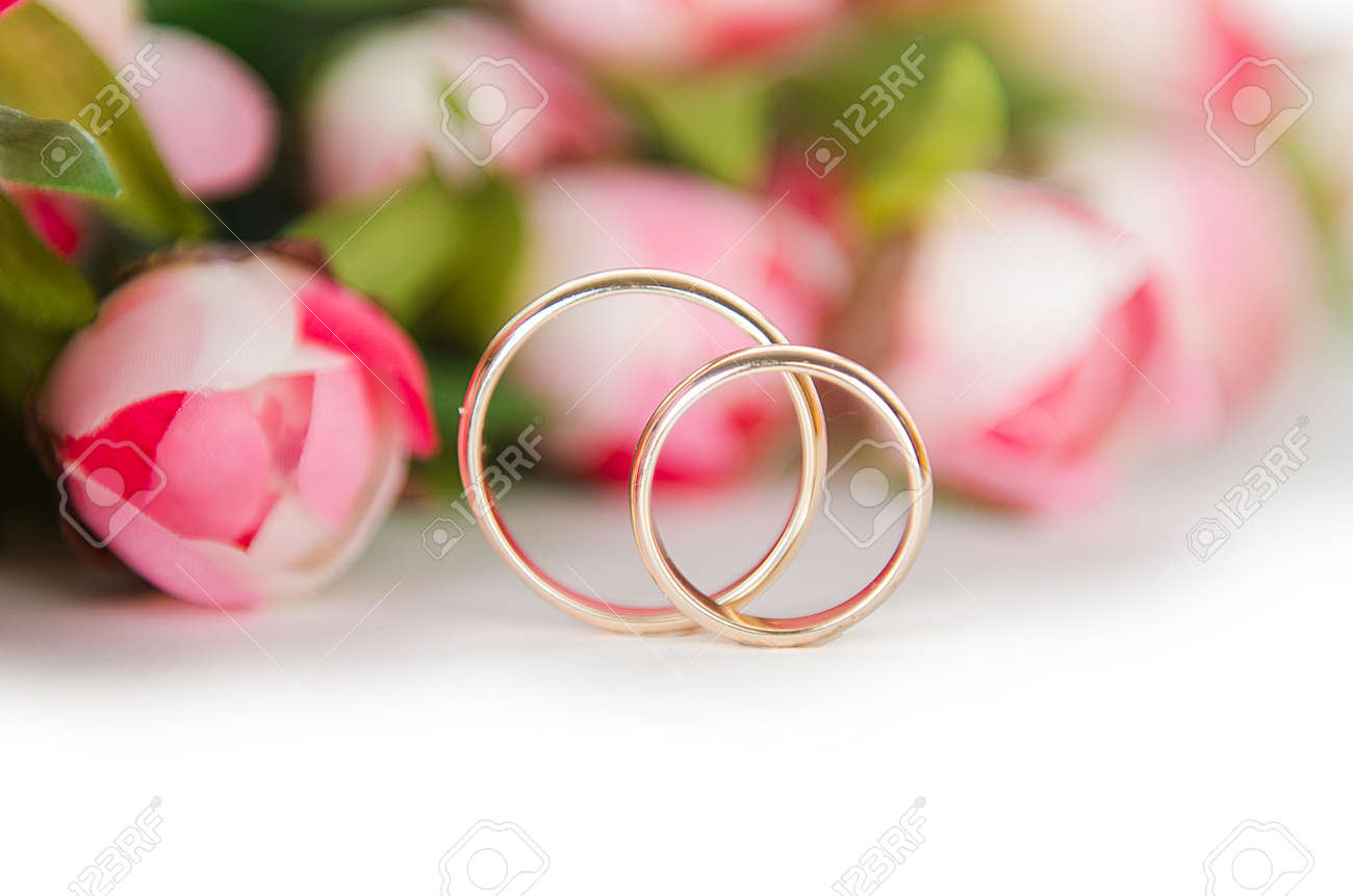 Wedding Rings And Flowers Isolated On White Background Stock Photo ...