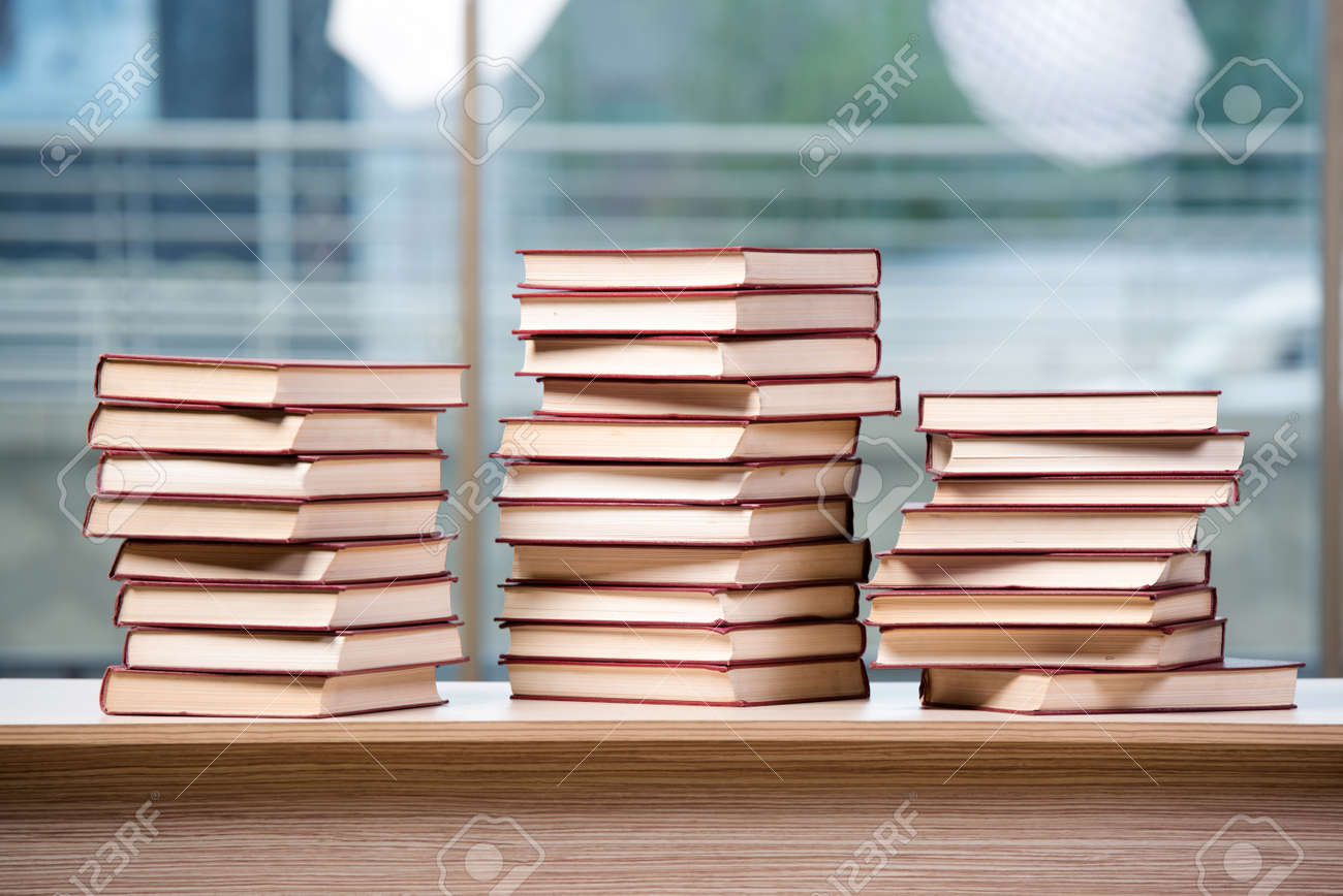 Sensational Stack Of Books Arranged The Office Desk Download Free Architecture Designs Ogrambritishbridgeorg